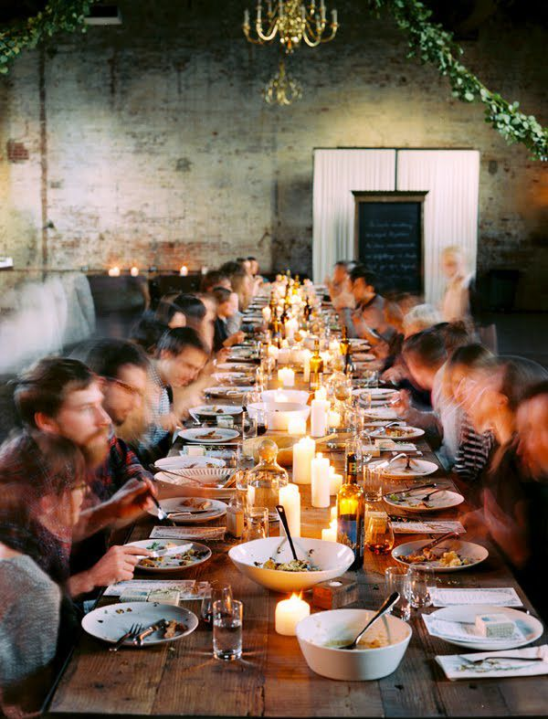 Long wood communal table with perfect candle light