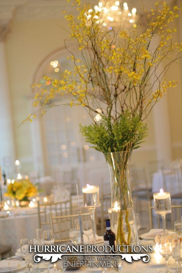 Simple, tall centerpiece using branches and ferns at a wedding at Addison Park in Aberdeen Township, NJ