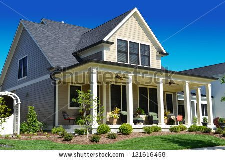 Beige Suburban American Cape Cod Home With Large Front