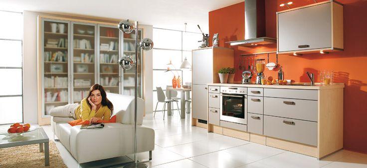 Open Plan White and Orange Kitchen with Long Modern Kitchen Island