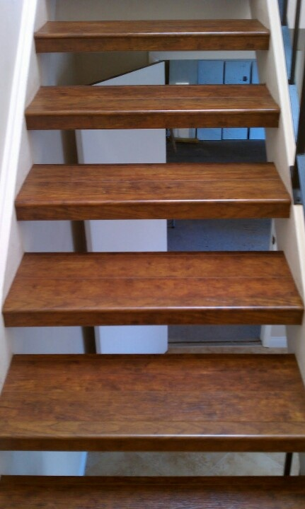 Laminate wood flooring on floating steps. It can be done :)