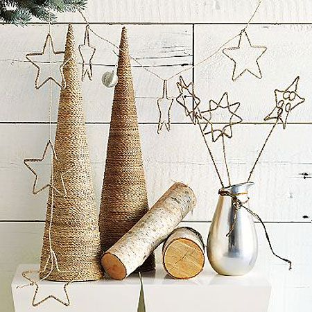 Natural lupis twine cone trees & star garlands by David Stark for West Elm. *Note to self:  Pinned a separate tutorial for how to make these stars.