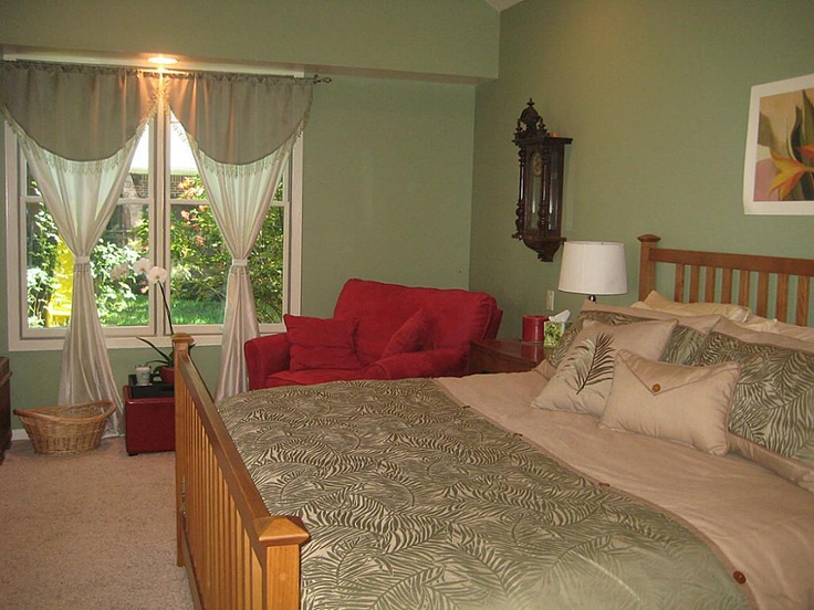zen sage green bedroom master with sitting area
