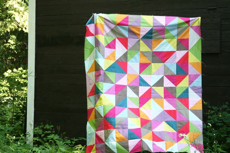 jewel-tone HST solids quilt by film in the fridge. wow.