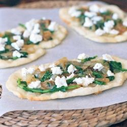 ... caramelized onions, peppery arugula, and tangy goat cheese. {gluten