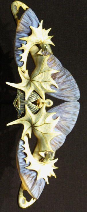 Lalique 1903 signed 'Thistles' Corsage Ornament: lavender glass thistles, w/undulating pale golden & pink enamel spiky leafage, w/ finely cast veining, joined by charcoal grey & olive green enam-eled branches: mounted in gold.
