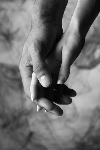 Fotografia agarrando las manos
