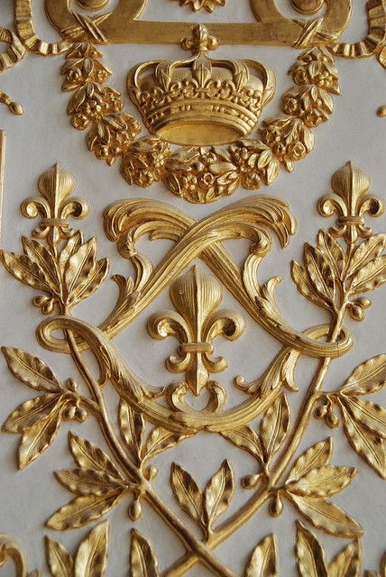 Fleur de Lis and the double 'L' for Louis; gilded wood from Versailles.