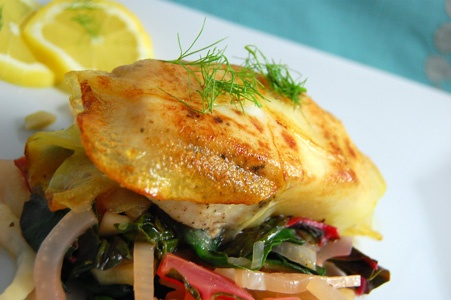 Potato Crusted Halibut with Sautéed Greens.
