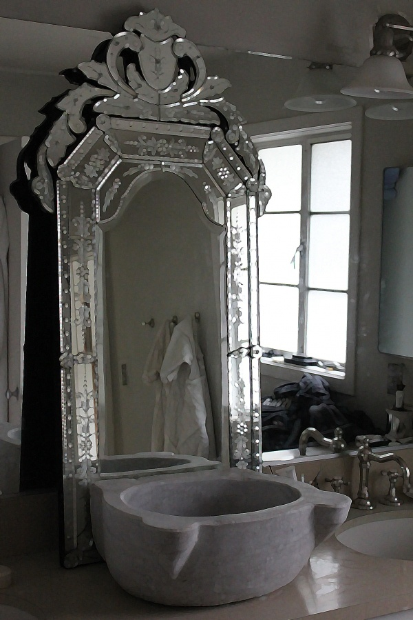 Venetian mirror and Turkish marble sink