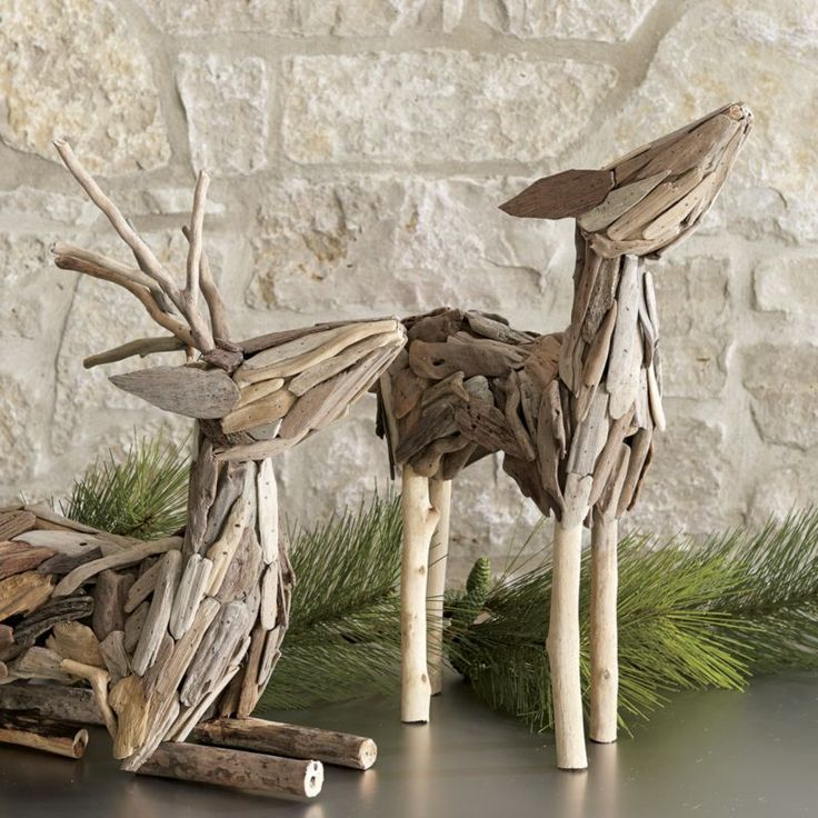 Bits of collected driftwood are pieced together into sculptural renditions of reindeer.  Lying and standing deer liven up seasonal décor with artful, eco-friendly whimsy.  Due to their handcrafted nature, deer will vary slightly. HandcraftedDriftwood and nailsDust with soft, dry clothMade in The Philippines.