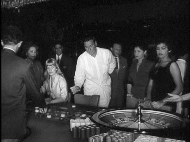 Download this Beverly Aadland Left Seated And Errol Flynn Casino Scene From The picture