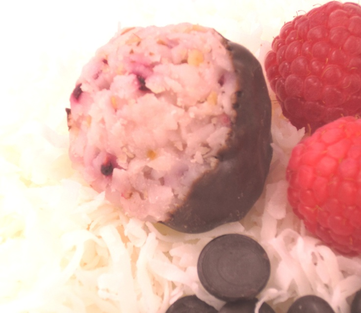 Raspberries and white chocolate macaroons then dipped in dark ...