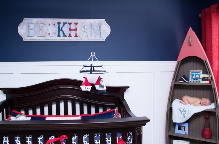 We love the bold navy blue choice for wall color in this nautical nursery. And I spy a super-sweet baby! #nursery #nautical