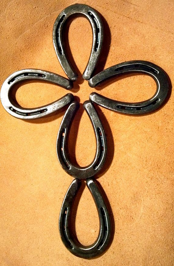 Cross made out of Horseshoes by MaceMetalandLeather on Etsy, $25.00