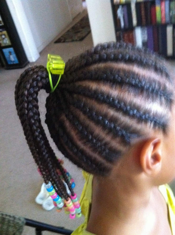 Little Girl Braids With Beads Little girl with braids and