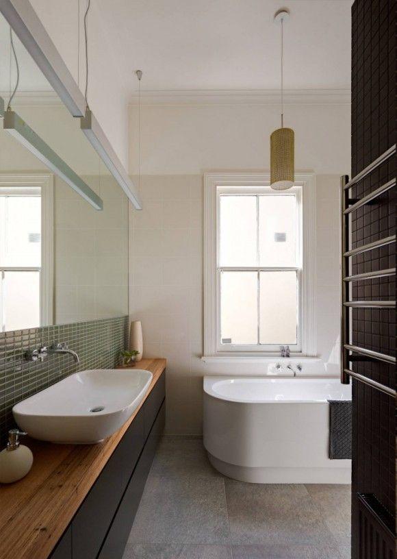 Wood countertop and backsplash tile! Love the bathroom!