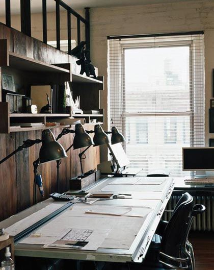 I like the row of vintage anglepoise lamps and the idea that depending on your current activity you move along the desk accordingly.