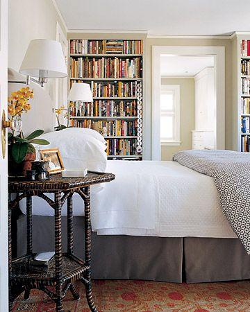 Wall of bookshelves in the bedroom = like
