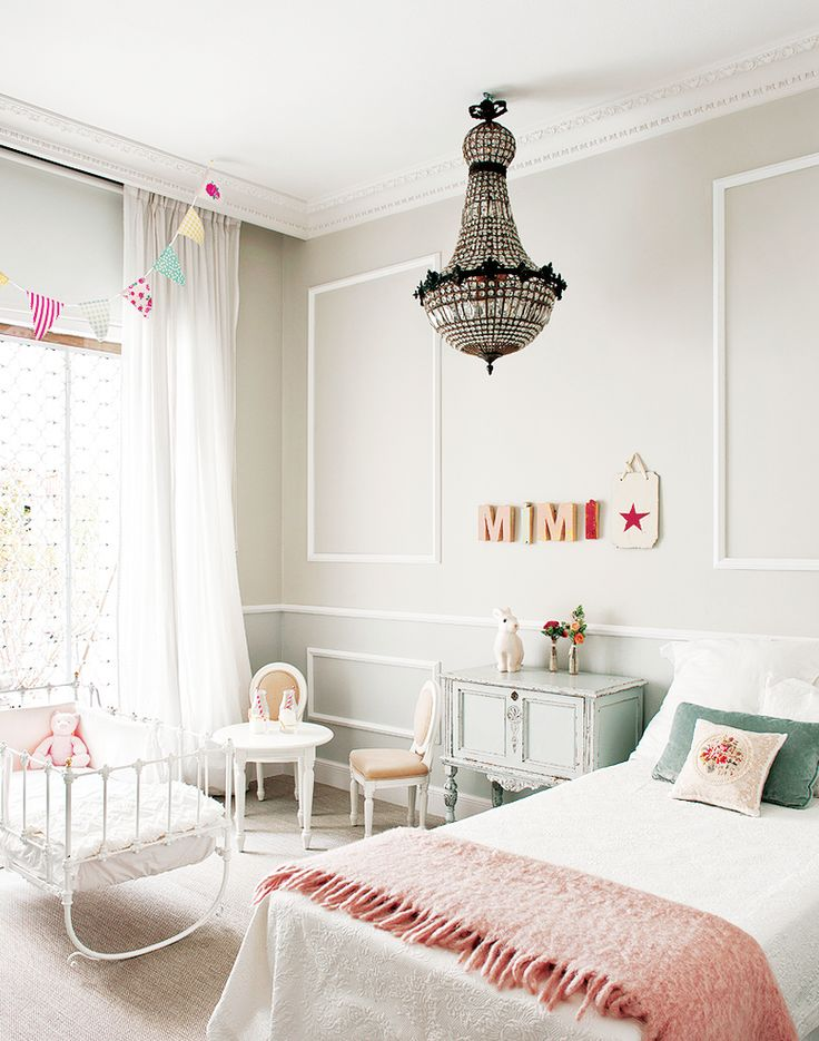 Inside a Groovy Pad Fit for a Queen// chandelier, pink blanket, girls room