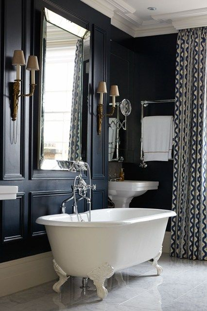 This bathroom takes my breath away. Stunning and elegant. The rich, dark color on the wall is regal in every way.