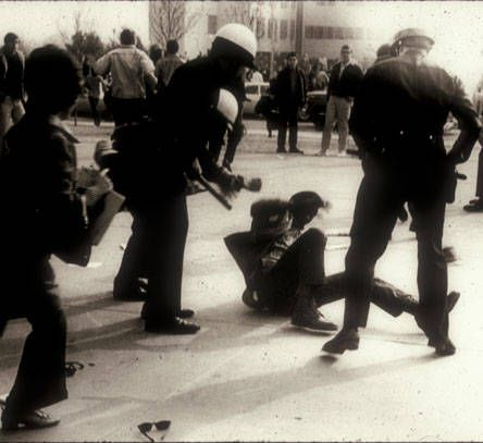 Police and student demonstrators meet on the campus of San Fernando Valley State College (now CSUN), January 8, 1969. In November of 1968, student activists with demands for educational reform, including ethnic studies departments, went into action on the SFVSC campus. The following January, a rally turned violent in front of the Administration Building. CSUN University Digital Archives.