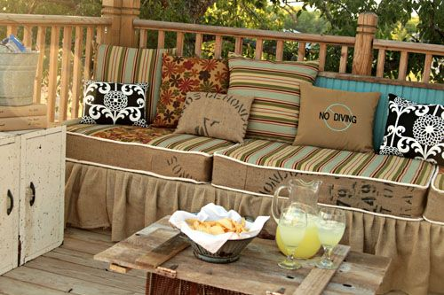 Deck furniture made from palettes, then skirted with burlap fabric.