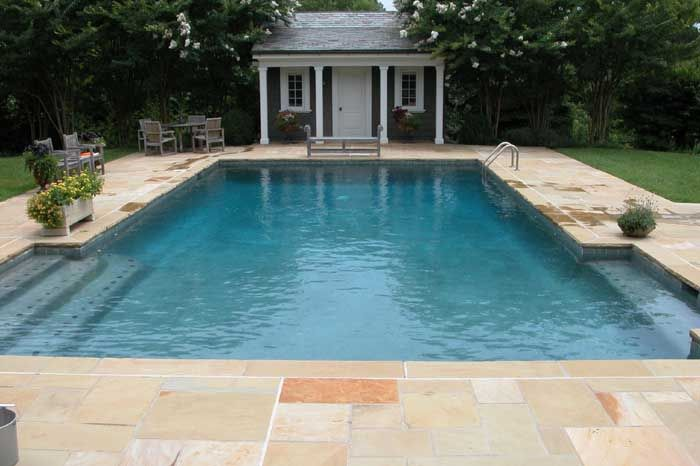 Flagstone surround and cute pool house swimming pool for Pool surround ideas