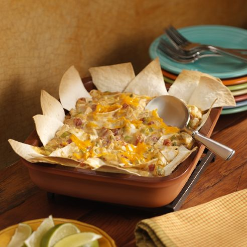 Creamy chicken and tomato casserole combined with flour tortillas for a southwestern flare