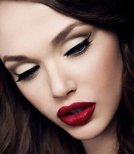 Bold lipstick and cat eyes.