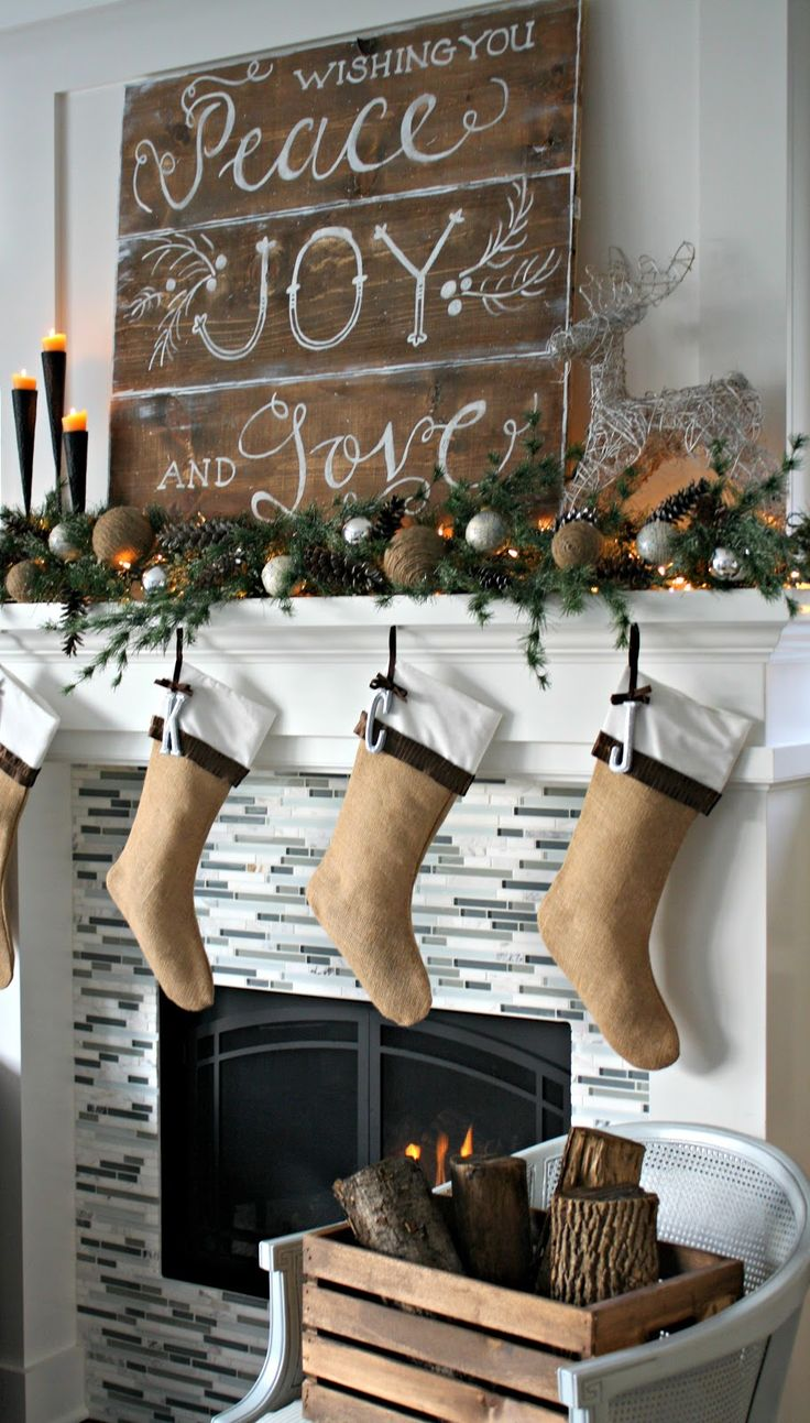 Rustic Christmas Mantel...love the handpainted signs on the wood and the burlap stockings.