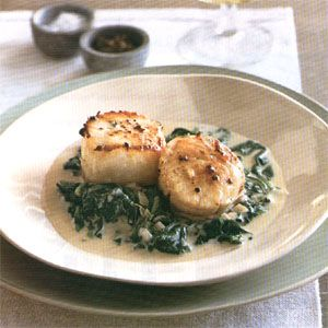 seared scallops on spinach with apple brandy cream sauce