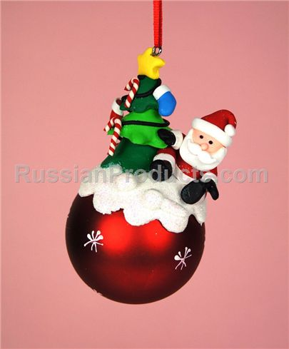 Santa with christmas tree on red ball ornament for holiday tree