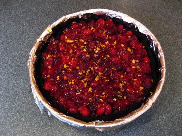 Cranberry Orange Pumpkin Cheesecake with Chocolate Cookie Crust