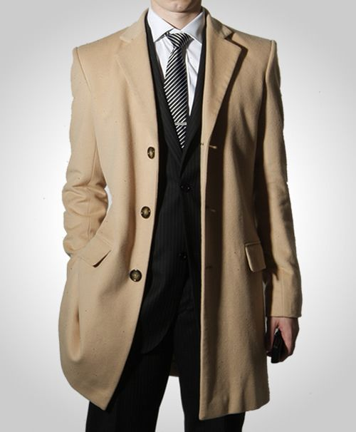 Camel cashmere overcoat. Richard is the ultimate smooth operator
