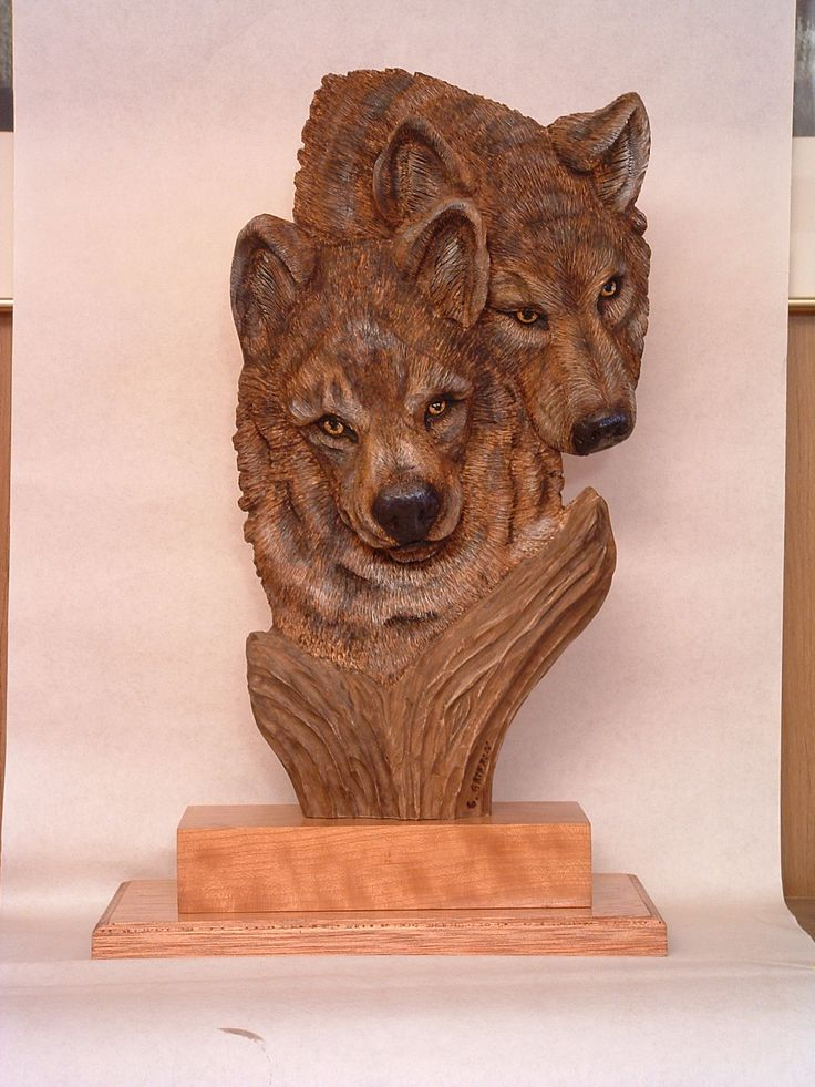 Wolves relief carving in the round