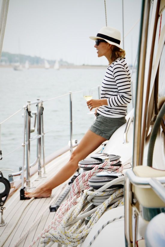summer.  nautical style: striped shirt, shorts, hat, + sunglasses.