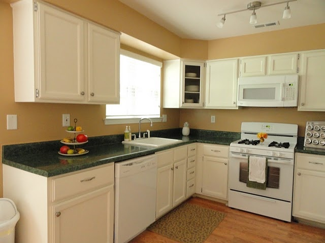 White kitchen cabinets with beige walls Do not like the green