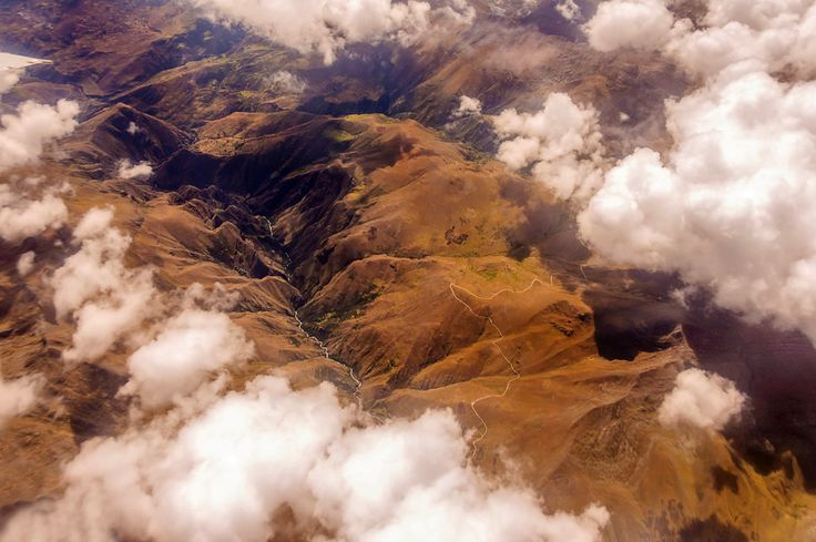 Aerial view of the Andes Mountains, seen through the clouds.