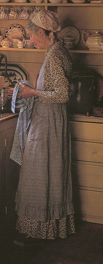 Tasha Tudor always wore an apron at home. (No link, but love this picture of her - MB)