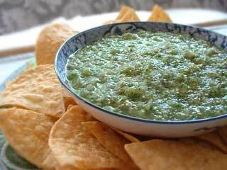 ... green salsa made with roasted tomatillos, chile peppers, lime juice