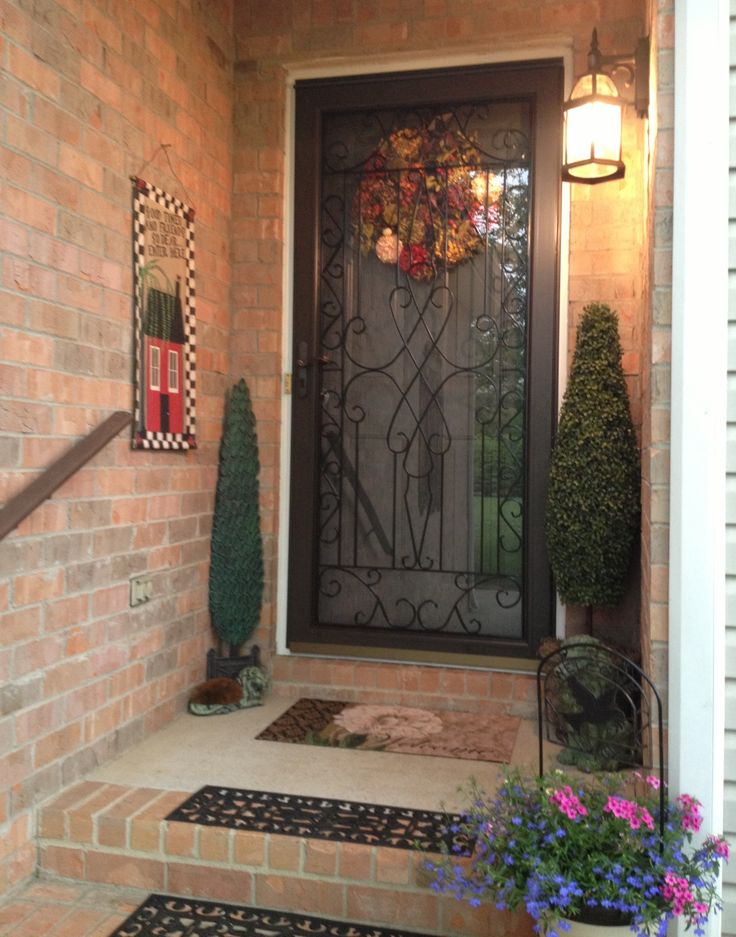 My Scrolled Iron Bronze Front Storm Door For The Home Pinterest