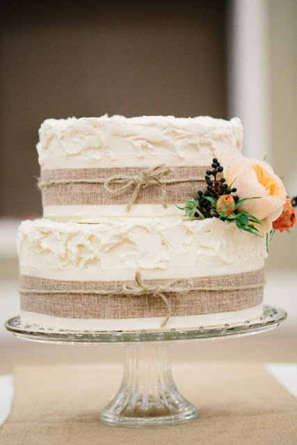 burlap and twine wedding cake... perhaps with lace in there as well? And three tiers of course...