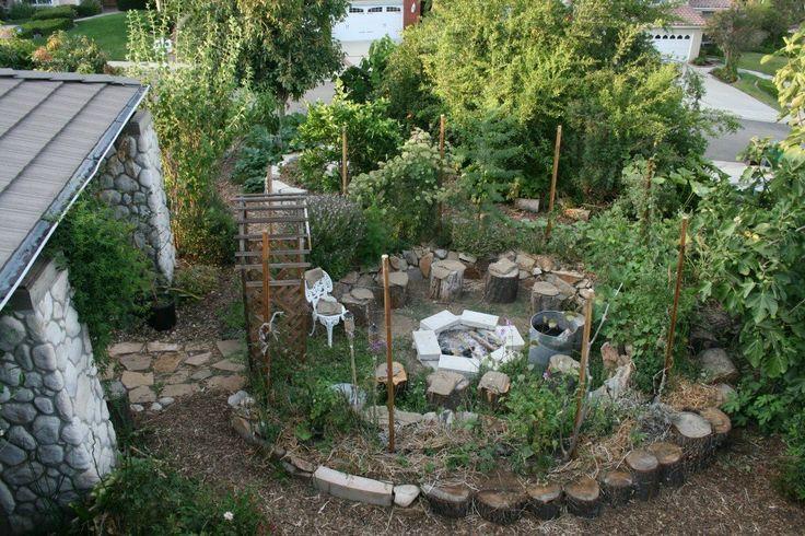 Fire pit inside a keyhole garden fire pits pinterest for Keyhole garden designs
