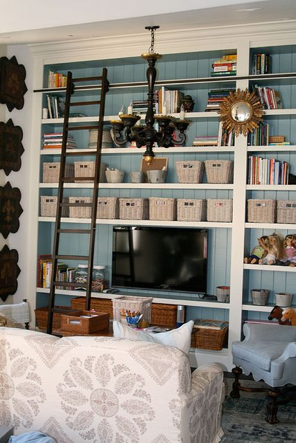 This may be the perfect solution to that black screen and the empty nook in my living room.  AStoriedStyle.com