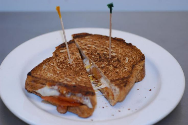 Cheddar cheeses with bacon and tomatoes grilled on a Panini press ...