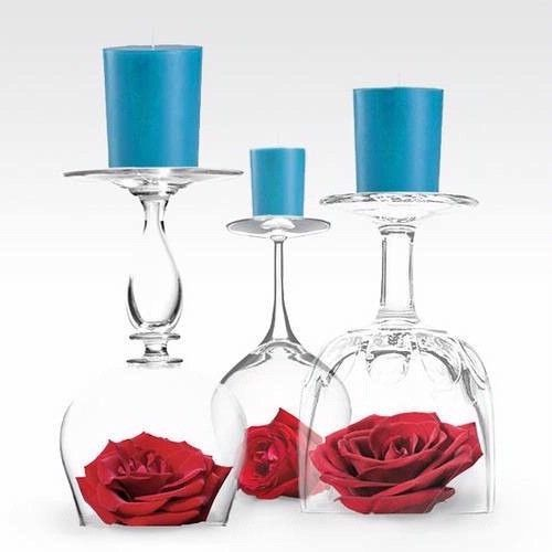 Upside down wine glass candle holder.