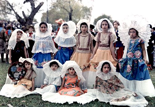 ... - Girls pose in Mexican costume and frilly headdresses, Brownsville