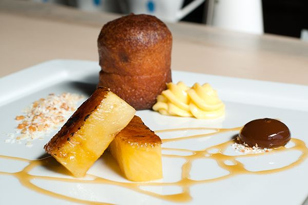 ... au Savarin dessert: baba, brûléed pineapple, and rum-filled bubble