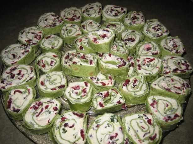 Simple & Delicious Cranberry Cream Cheese Pinwheels from Food.com:   These are super easy to make for a dinner party or as a dinner appetizer.  I always make them for the Christmas holiday season and use spinach tortilla rollups.